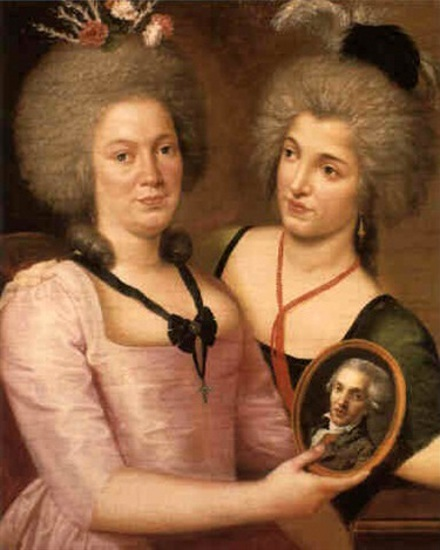 Two Ladies, One Holding An Oval Of A Man